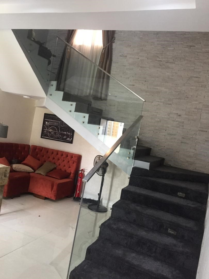 Dhaxle Frameless tempered railings in VGC, Lagos