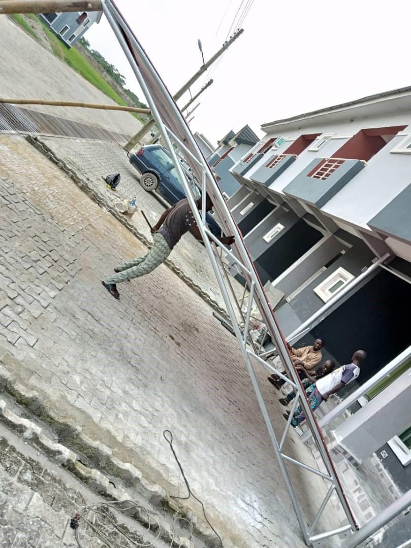 Dhaxle Frameless tempered glass railings with rectangular stainless steel top railings, Lekki, Lagos